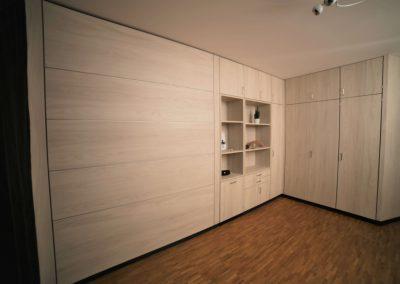Ausbau 1-Raum-Appartment mit Schrankwandsystem zur optimalen Raumausnutzung und Stauraumschaffung